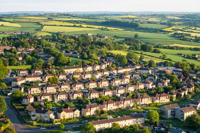 Landmark case sees local council take back rent from a rogue landlord - Image showing an aerial view of suburban streets and fields