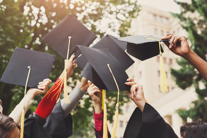 Paying uni fees from buy to let profits - Image showing students graduating